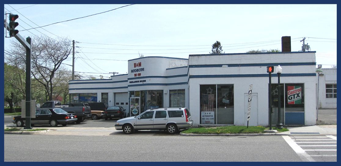 Exterior view across the street of an auto repair building on 1 Pond lane, Southampton, NY.