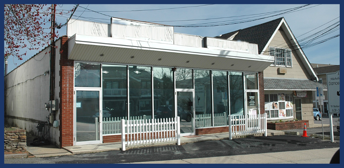 Exterior view of a vacant storefront retail building on 19 Bellemeade Avenue, in Smithtown, NY.